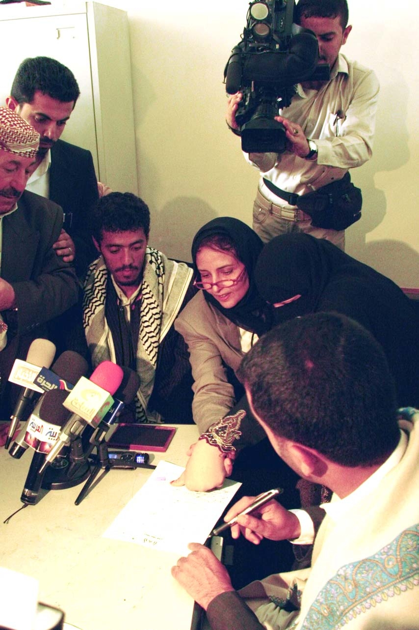 The moment 12-year-old Sally al-Sabahi signed her divorce papers in Sanaa, the Yemeni capital. After the divorce she thanked all the people that made it possible