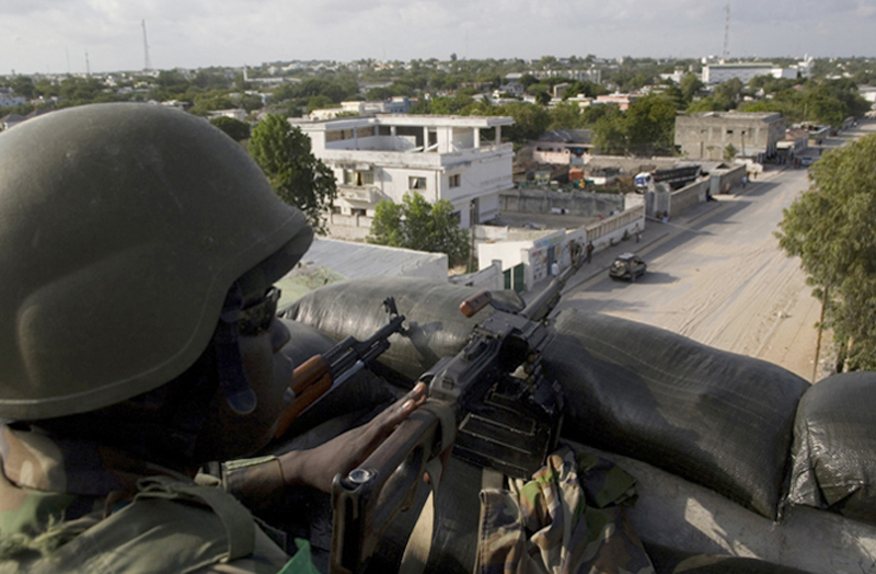 An African Union peacekeeper guards the surrounding area of an AU controlled post in Mogadishu on April 1, 2010. Allegedly, Somalia's transitional government is gearing up for a major offensive against the Shabab, a militant Islamist group who now control