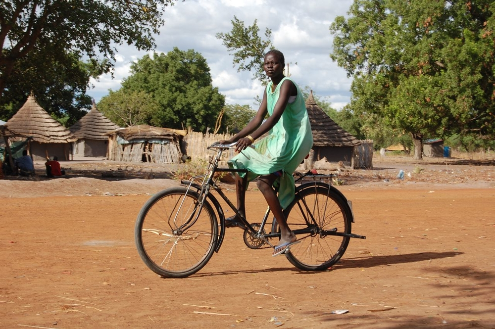 A girl rides her bike into Cueibet town, Southern Sudan, May 2, 2010