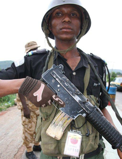 "Member of the para-military Mobile Police, commonly known as ""kill and go"", at a roadblock in Jos - May 2010"
