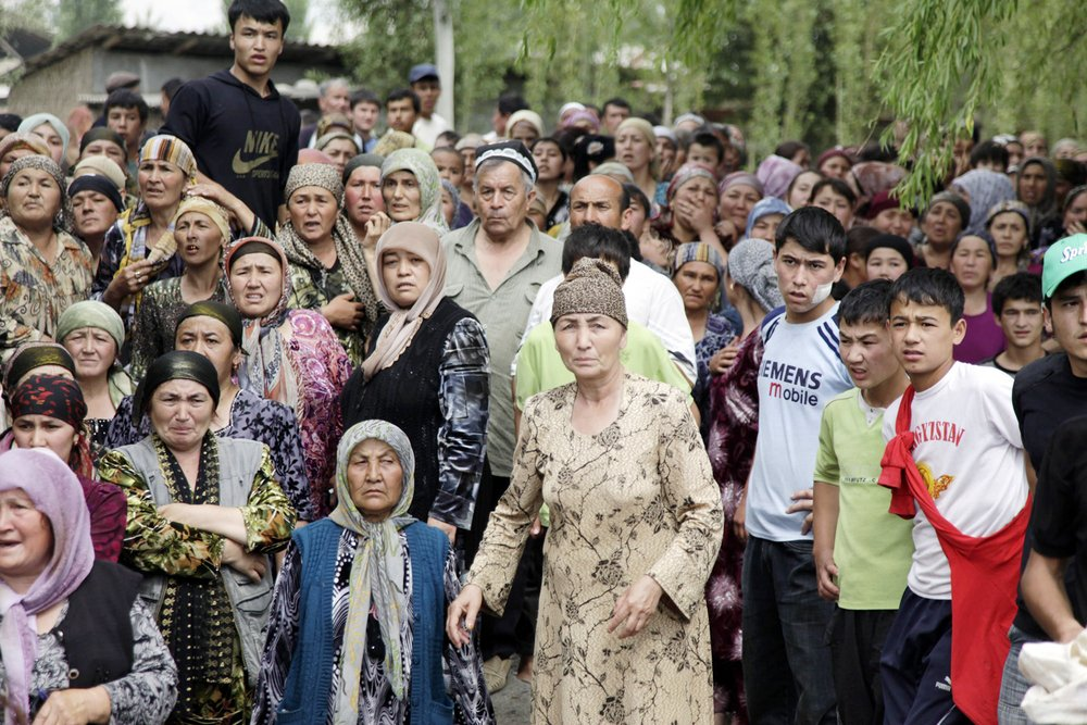 Ethnic Uzbeks fleeing violence in Osh, Kyrgyzstan, form a refugee camp in the border town of Nariman, hoping to enter Uzbekistan on 15 June