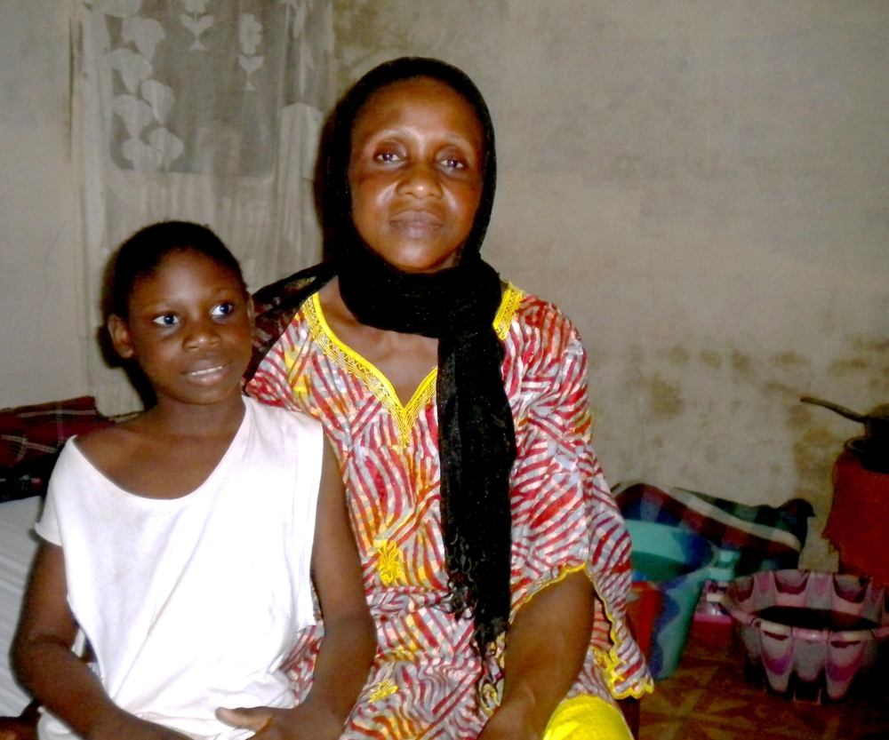 Woman in Dakar, Senegal, with her eight-year-old daugher who has a mental disorder