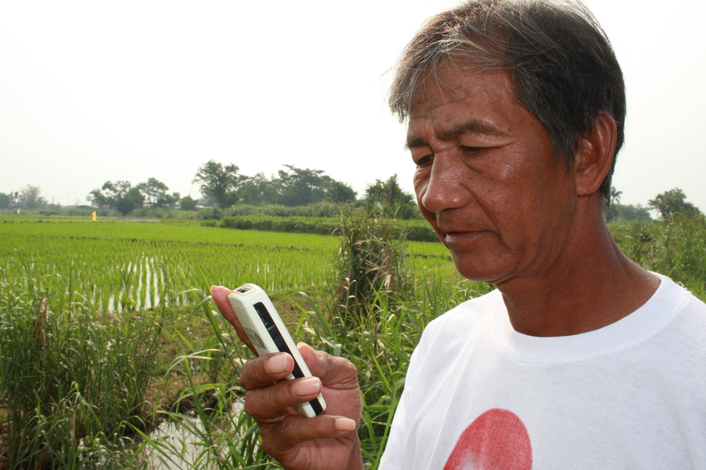 Nonilan Sulibat, a rice farmer in Laguna Province, will soon receive expert advice on how to increase his field's productivity on his mobile phone. Rice is a staple part of the Filipino diet