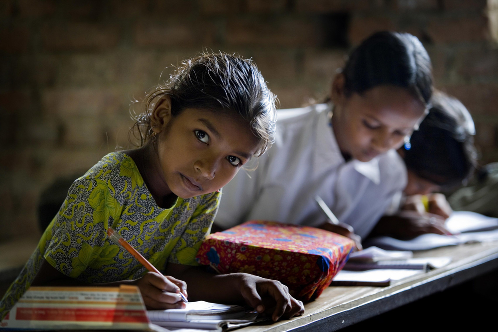 A young girl attends a school near Bhairawaha, Rupandehi District, south-central Nepal