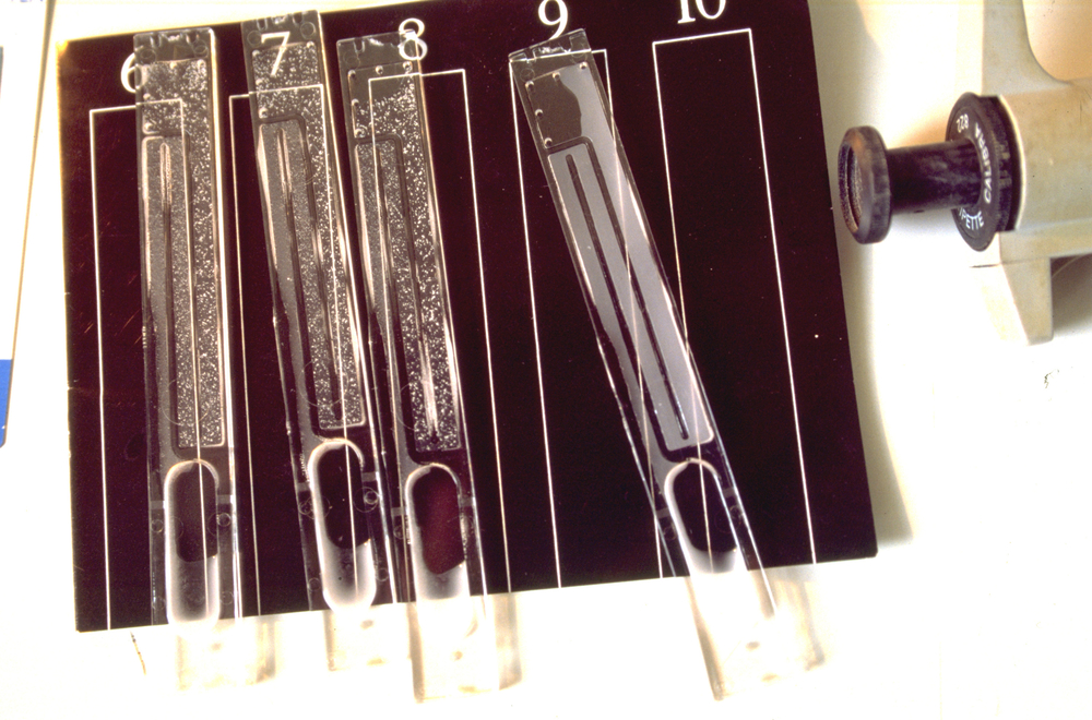 The results of a rapid test for HIV/AIDS at Baragwanath Hospital's maternity section in Soweto. In the samples shown, three positive tests appear chalky against the black test scale while a negative test is opaque. For generic use. PlusNews