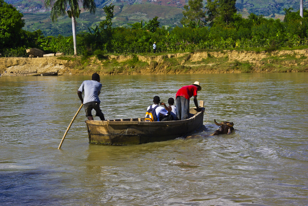 People in many Haitian communities must cross the Artibonite River to get to a health centre. November 2010