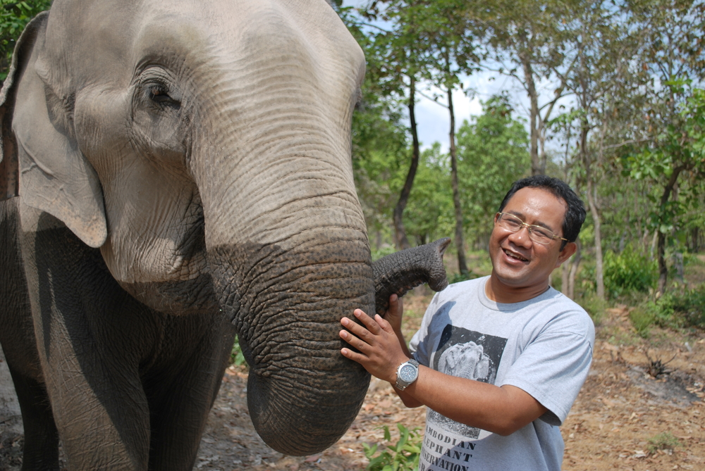 Sereivathana Tuy attends to elephants at Phnom Ta Mao Zoo in Takeo, a province in southeastern Cambodia