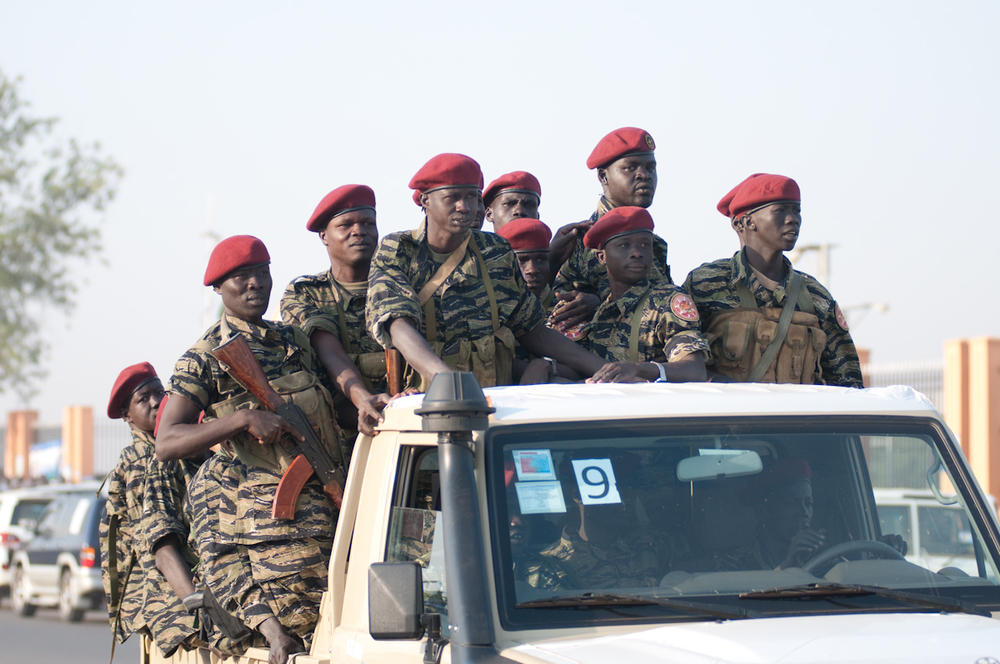 South Sudanese soldiers patrol the streets of Juba as voting gets under way in the week-long referendum beginning 9 January 2011 to decide whether the region splits away from the North