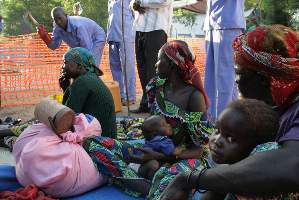 Local health workers talk with people about sanitation at a cholera treatment centre in Bongor, southern Chad. November 2010