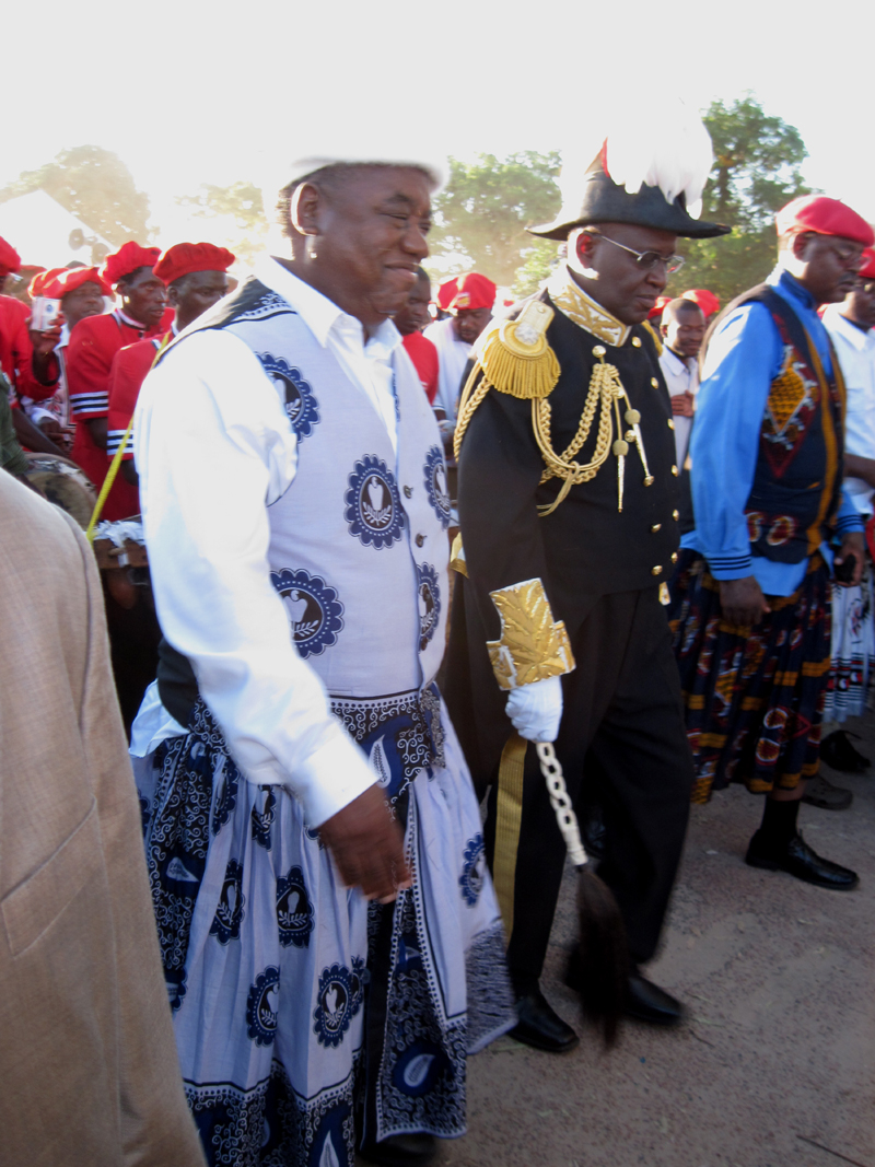 President Rupiah Banda (left) walks with the Lozi king, Lubosi Imwiko II, at the Kuomboka ceremony that marks the annual flooding of the Zambezi river