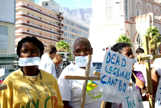 "More than 100 people gathered outside Parliament in Cape Town on 14 March to support the call for action on the increasingly common hate crime of ""corrective rape"""