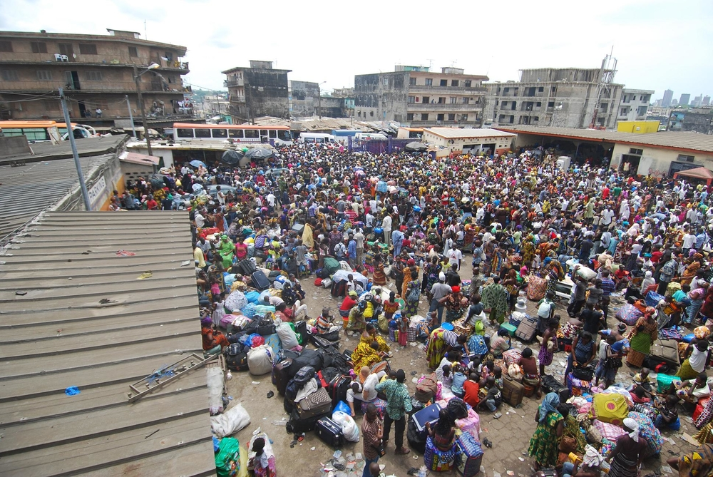 People at a bus station in Abidjan's Adjamé District, looking to flee the increasingly severe post-election fighting. March 2011
