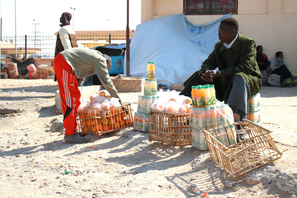 A Migrant worker selling basic items at Salloum, the main border crossing point between Egypt and Libya
