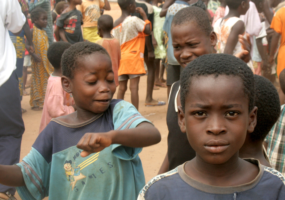 Children singing 'We want peace'. Catholic mission site in Duékoué, western Côte d'Ivoire. April 2011