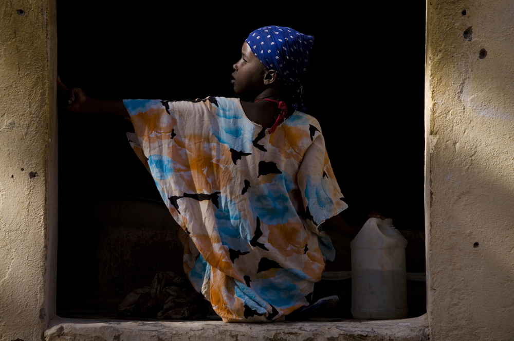 A girl prepares to wash clothes at the MSF Holland hospital laundry in Galcayo South in Puntland, Somalia. Women and children are particularly hard hit with one in twelve women dying during childbirth and one in seven children dying before their first bir