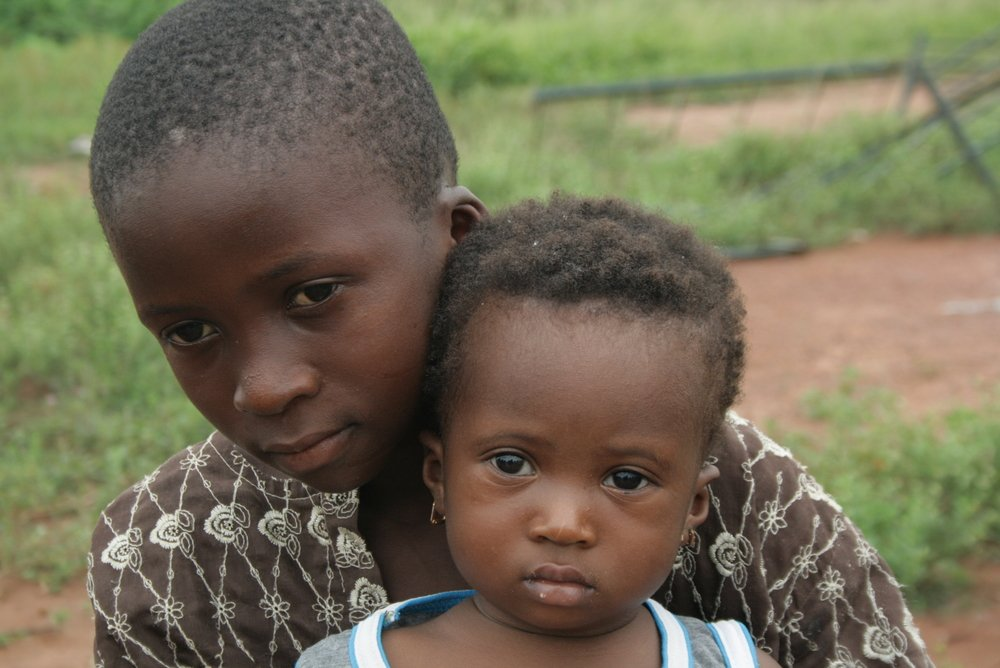 Children at a site for displaced families in Man, western Côte d'Ivoire. Their family fled clashes between the Guéré and Malinké communities in Duékoué. April 2011
