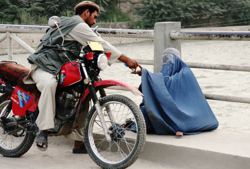 A woman begging in Faizabad, provincial capital of northeastern Badakhshan province. Poverty and unemployment are among the main causes of women and children trafficking in Afghanistan