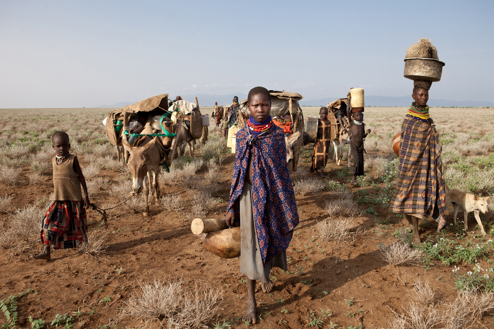 Women, children and donkeys on the arid plains at the feet of the Mogila mountains in Turkana, northern Kenya