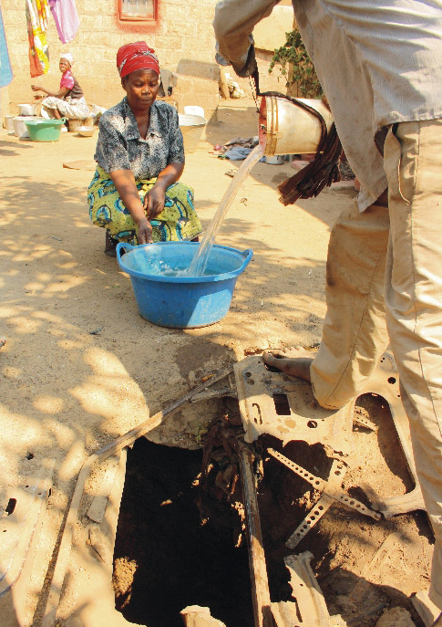 Overflowing sewage pollutes open wells like this one in Zambia