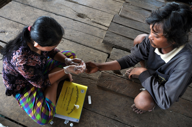 A village malaria worker (VMW) administers a simple blood test for malaria in Pailin, considered the epicentre for drug-resistant malaria. There are close to 3,000 VMWs in Cambodia today