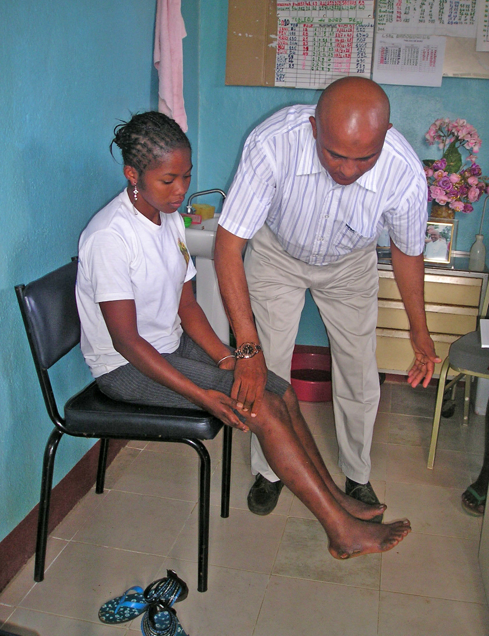 Dr Abdoul Zamandrahengo examines a patient with early stages of leprosy at his clinic in Antalaha on the East coast of Madagascar