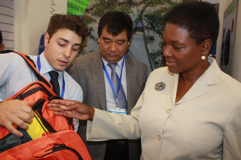 Valerie Amos, the UN's top humanitarian official, examines a six-day disaster preparedness kit at the 3rd Shanghai International Disaster Reduction and Security Exhibition 2011 on 12 October 2011