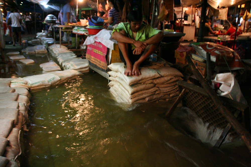 A Bangkok resident watches as flood waters rise around him. 13 October 2011