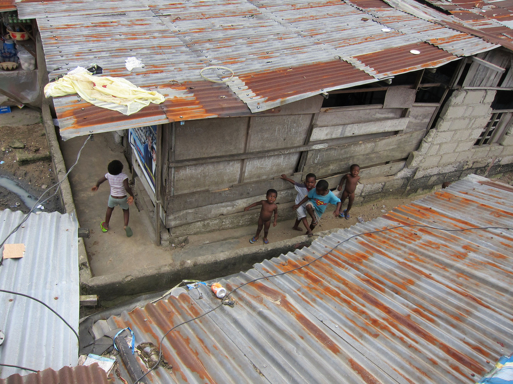 Children play in the street at Bundu waterfront, one of the sprawling shanty towns in Port Harcourt, Nigeria