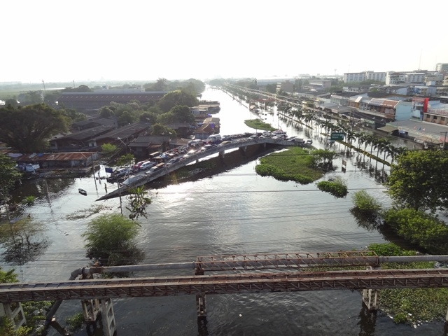 Car owners sought out elevated highways to escape rising floodwaters in and around Bangkok