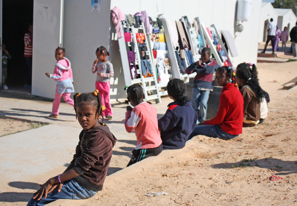 "Children at the site for people displaced from the town of Tawergha during the 2011 Libyan civil war. ""Airport Road / Turkish compound"" site in Tripoli, November, 2011."