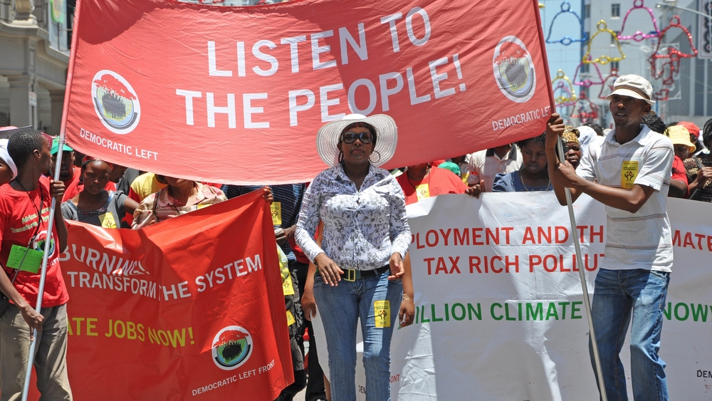 Protestors from the Democratic Left Front join thousands of other activists on the Global Day of Action in Durban