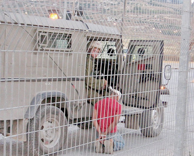 Israeli soldier arresting 12 year-old palestinian youth at Nablus checkpoint
