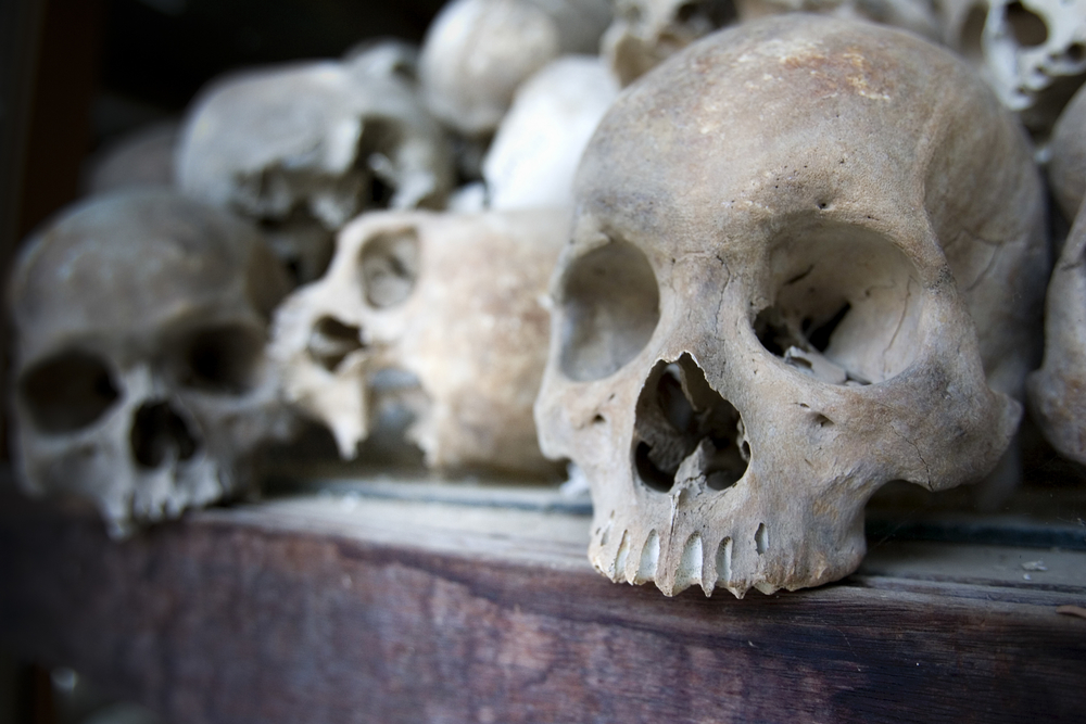 Human skulls form a display at the Toul Sleng Genocide Museum in Phnom Penh, Cambodia, March 13, 2005.  According to government sources about 500 people a day visit the museum where an estimated 14,000 people were tortured and later executed. The building