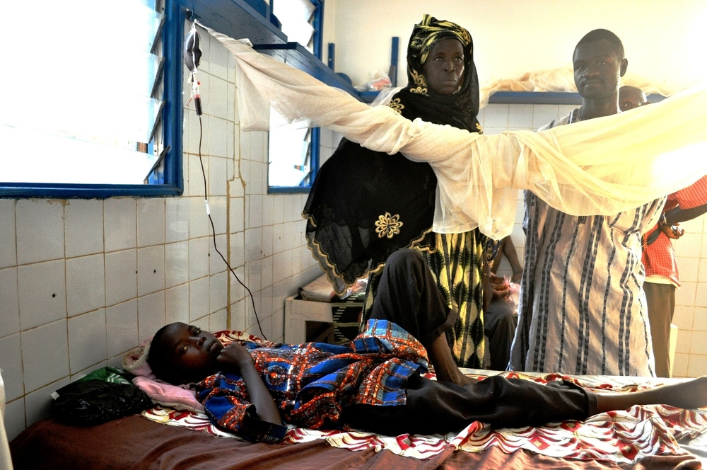 Soumaila Djiré, 13, lays in Man hospital's pediatric ward battling malaria. Doctors have one packet of blood for him, but the pediatrician says he will need more. His family has no means to visit the blood bank 180 kilometeres away