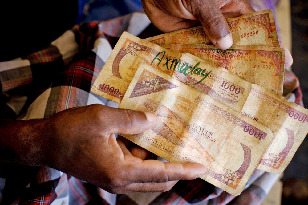 A man holds currency notes in Mogadishu, Somalia
