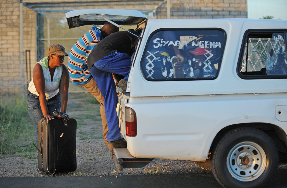 After jumping the border between Zimbabwe and South Africa, illegal migrants climb into a waiting vehicle that will transport them to the nearby town of Musina