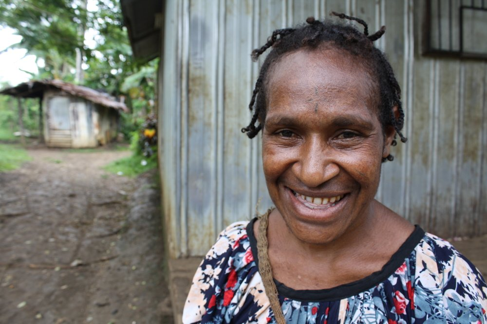 A woman looks to the camera in Madang Province, northern Papua New Guinea