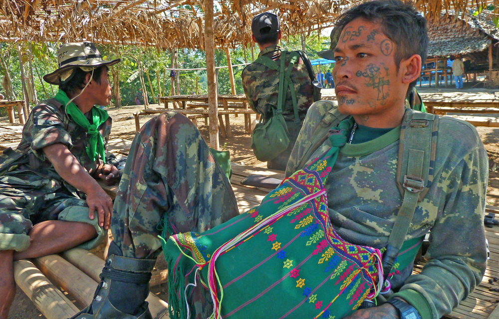A tatooed Karen soldier in eastern Myanmar. Thousands have been displaced in what has been described as one of the world's longest running conflicts