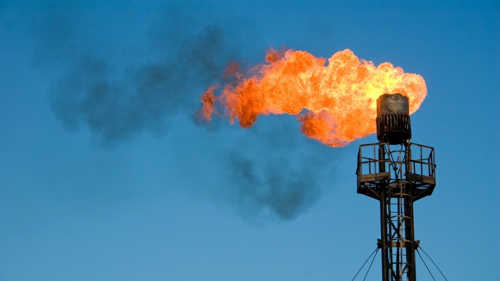 Burning oil flare. Gas flaring in the Niger Delta has caused tremendous damage the environment and human health