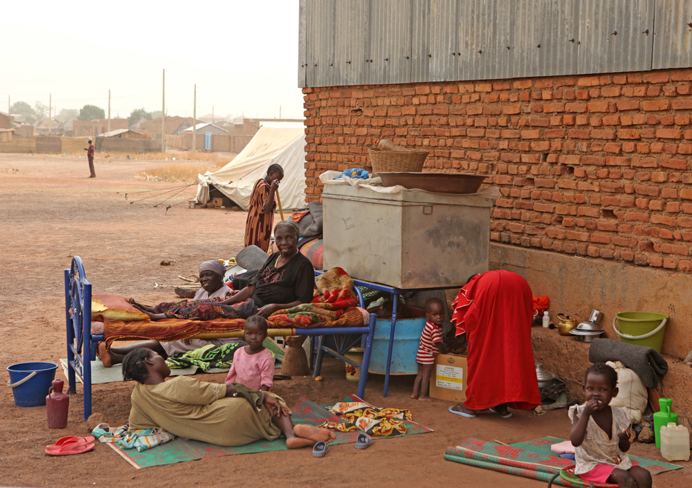 Returnees in Wau, South Sudan, camped at a warehouse as they wait for their applications for a plot of land to be processed