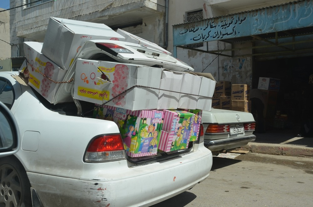 A taxi, stuffed with products, arrives in the Jordanian border town of Remtha from Syria. Despite the unrest, trade across the border has continued. On the way back, these taxis sometimes also carry hidden medical supplies to be distributed to those affec