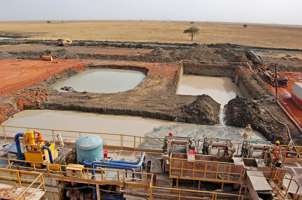 Oil well drilling pits at Heglig, central Sudan