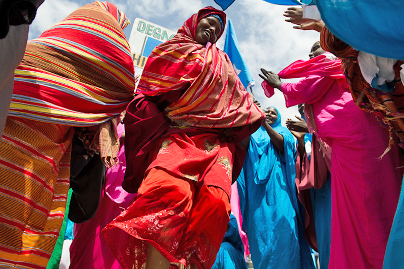 Somali women dance during a celebration to welcome back Abdiweli Mohamed Ali, the country's Prime Minister, at Mogadishu's Aden Adde International Airport on March 11, 2012