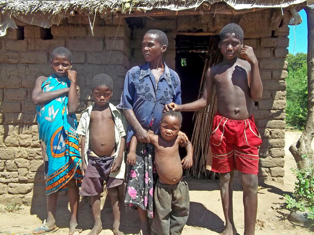 Mary Lyford with four of her children in front of their home in Mbande Village in southern Malawi's Chikhwawa district. Erratic rains meant Lyford harvested nothing from the family's one hectare plot this year. Food assistance from the government ende