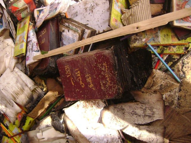 A charred bible among the detritus in a Khartoum church compound that was attacked by a mob on 21 April