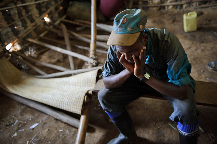 A displaced Congolese man (who wishes to remain anonymous) sits in a classroom of the Katoyi primary school being used by displaced people for shelter in Masisi territory of the Democratic Republic of the Congo's North Kivu province on June 4, 2012