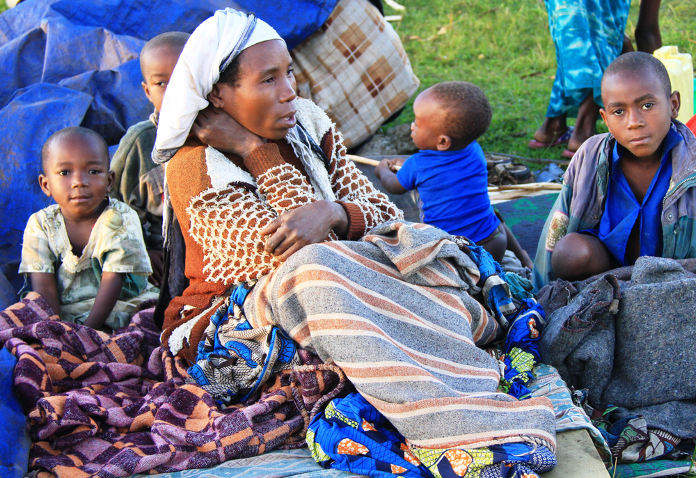 A Congolese refugee woman and her children at Nyakabande transit centre, Kisoro district, Uganda. May 2012