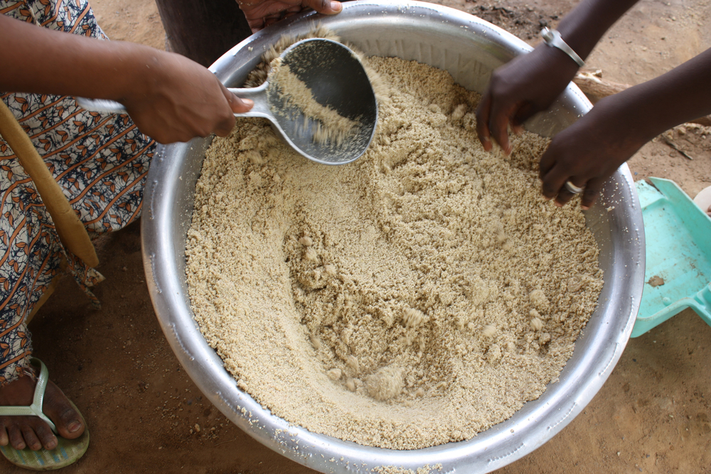 Families in the drought-affected Djoke village in Gorgol region, one of the three regions that form Mauritania's triangle of poverty pool their food reserves and eat together every day