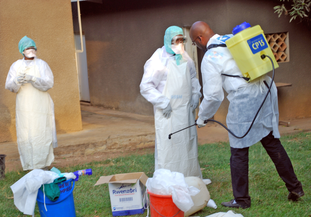 Doctor Yab Boun disinfecting colleagues before they investigate suspected Ebola cases at a new isolation centre at Mbarara Referral Hospital, south of the affected Kibaale district in western Uganda