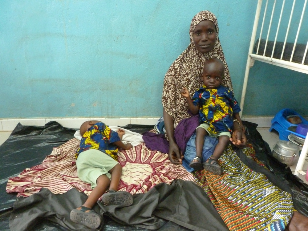A mother and her malnourished twins at Mopti reference hospital in central Mali, July 2012. Malnutrition rates - both chronic and acute - are always unacceptably high in Mali, whether harvests are good or bad